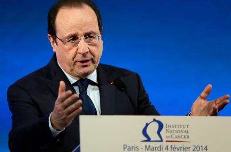 French President Francois Hollande delivers a speech to present the third 'plan cancer', a fight...