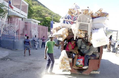 A Haitian merchant takes his goods to the Dominican Republic on a road by Lake Azuei February 5,...